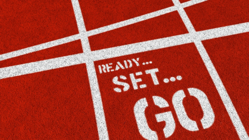 The words READY SET GO on a synthetic athletics track. 3D render with HDRI lighting and raytraced textures.